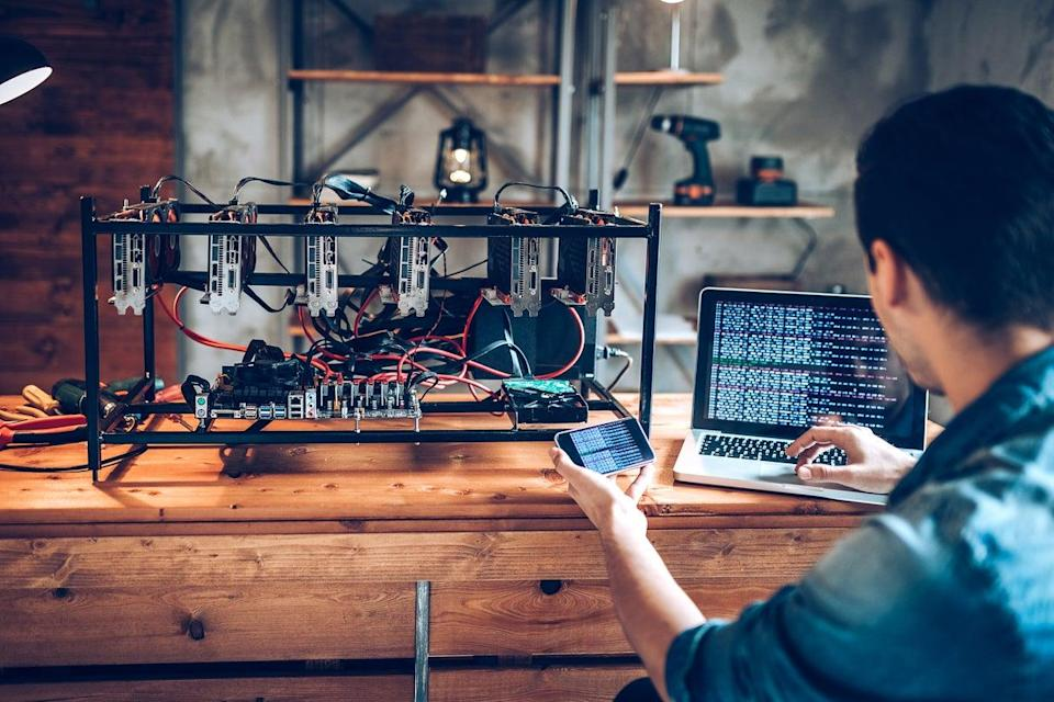 <p>A programmer prepares a Bitcoin mining rig</p> (Getty Images)