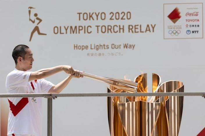 The flame was used to light a cauldron outside the Tokyo local government building in the hours before the opening ceremony