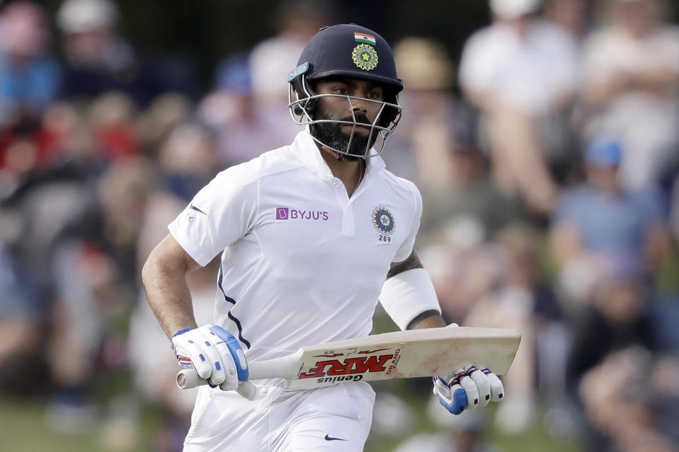 FILE - In this March 1, 2020, file photo, India's Virat Kohli runs a single while batting during play on day two of the second cricket test between New Zealand and India at Hagley Oval in Christchurch, New Zealand. India's cricket tour to Australia is closer to being formalized with selectors picking squads for a four-test series and the one-day and Twenty20 limited-overs formats. (AP Photo/Mark Baker, File)