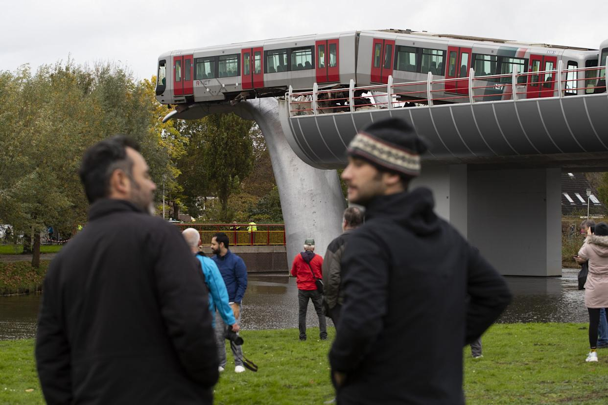 The whale's tail of a sculpture caught the front carriage of a metro train as it rammed through the end of an elevated section of rails with the driver escaping injuries in Spijkenisse, near Rotterdam, Netherlands, Monday, Nov. 2, 2020. (AP Photo/Peter Dejong)