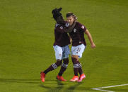 Colorado Rapids forward Diego Rubio (11) is congratulated by Lalas Abubakar (6) after scoring a goal against Real Salt Lake during the second half of an MLS soccer match Saturday, Aug. 21, 2021, in Commerce City, Colo. (AP Photo/ Jack Dempsey)