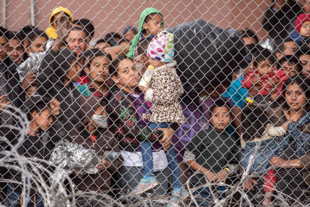 Migrants are gathered inside the fence of a makeshift detention center in El Paso, Texas on Wed. March 27, 2019. | Sergio Flores—The Washington Post/Getty Images