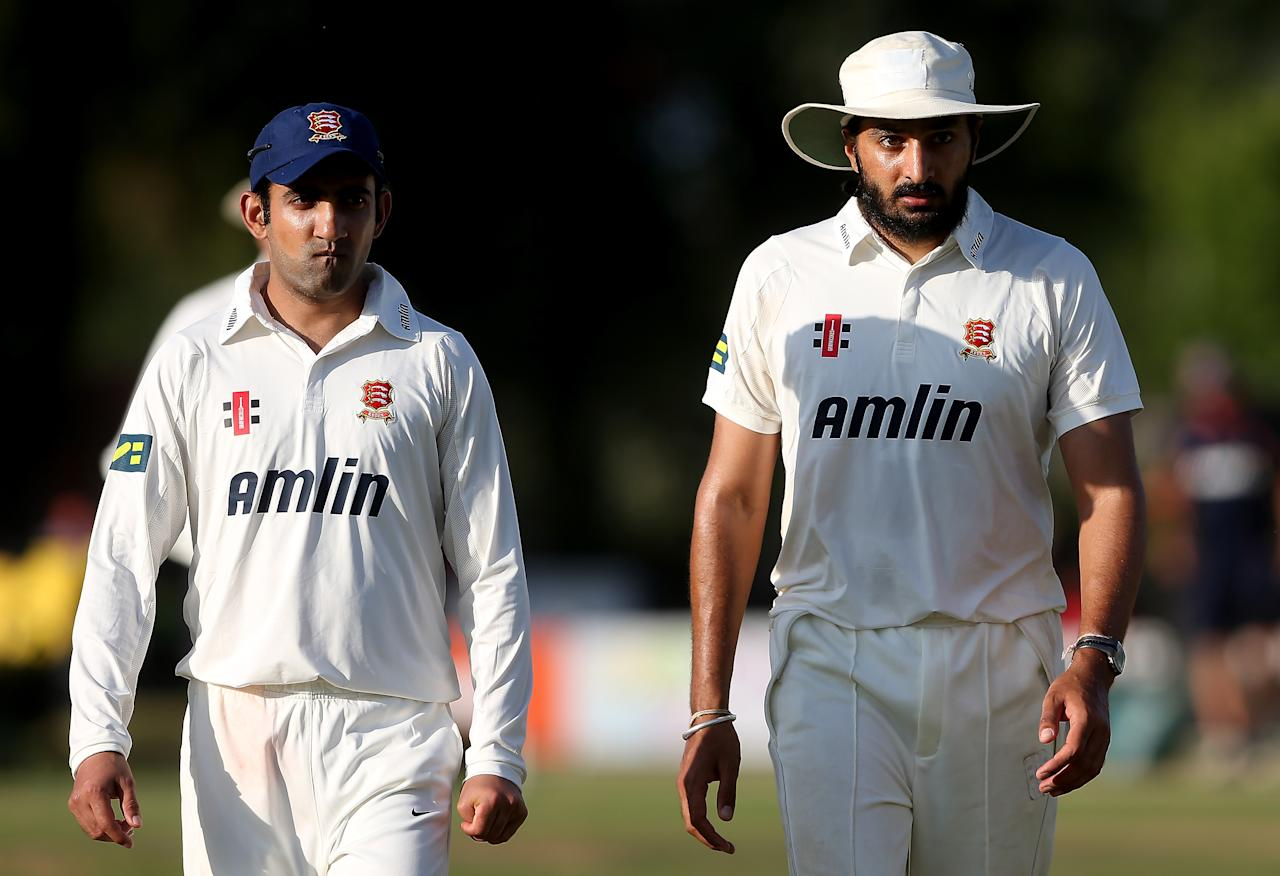 COLCHESTER, ENGLAND - AUGUST 20:  Gautam Gambir (L) and Monty Panesar of Essex during day one of the LV County Championship Division Two game between Essex and Northamptonshire at Castle Park on August 20, 2013 in Colchester, England.  (Photo by Scott Heavey/Getty Images)