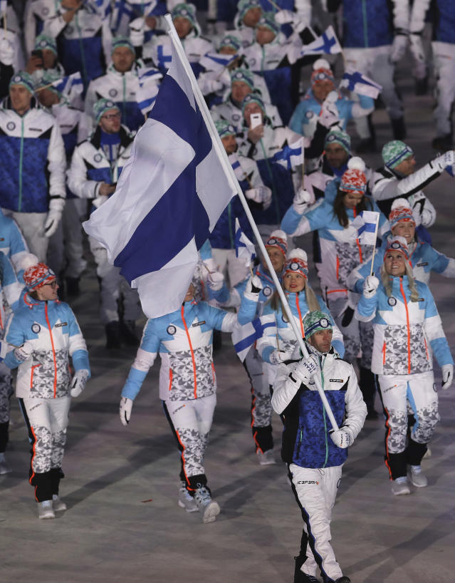 <p>Janne Ahonen carries the flag of Finland during the opening ceremony of the 2018 Winter Olympics in Pyeongchang, South Korea, Friday, Feb. 9, 2018. (AP Photo/Michael Sohn) </p>