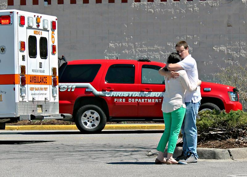 People gather in front of New River Valley Mall as police evacuate the building, Friday, April 12, 2013, in Christiansburg, Va. A man shot and injured two women. One of the victims was airlifted to a hospital. The other victim was taken by ambulance for treatment. (AP Photo/The Roanoke Times, Mike Shaw) LOCAL TV OUT; SALEM TIMES REGISTER OUT; FINCASTLE HERALD OUT; CHRISTIANSBURG NEWS MESSENGER OUT; RADFORD NEWS JOURNAL OUT; ROANOKE STAR SENTINEL OUT; MAGS OUT