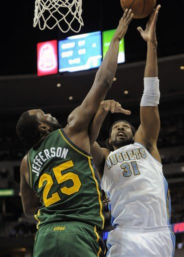 Denver Nuggets center Nene (31) from Brazil shoots over Utah Jazz center Al Jefferson (25) during the first quarter of an NBA basketball game, Sunday, Jan. 15, 2012, in Denver. (AP Photo/Jack Dempsey)