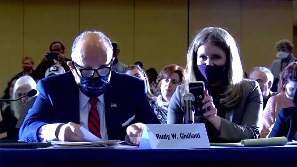 Rudy Giuliani and Jenna Ellis listen to President Trump on the speaker phone during the hearing. (via Reuters TV)