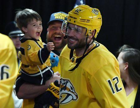 Apr 20, 2018; Nashville, TN, USA; Nashville Predators center Mike Fisher (12) takes the ice for warmups after kissing his son Isaiah Fisher prior to game five of the first round of the 2018 Stanley Cup Playoffs against the Colorado Avalanche at Bridgestone Arena. Mandatory Credit: Christopher Hanewinckel-USA TODAY Sports