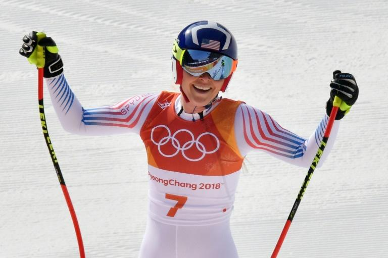 USA's Lindsey Vonn, who won the bronze medal, crosses the finish line in the women's downhill at the Pyeongchang 2018 Winter Olympic Games on Wednesday
