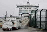 Cars are loaded onto a cross-channel ferry at the Port of Dunkerque, France, Friday Aug.14, 2020. British holiday makers in France were mulling whether to return home early Friday to avoid having to self-isolate for 14 days following the U.K. government's decision to reimpose quarantine restrictions on France amid a recent pick-up in coronavirus infections. (AP Photo/Olivier Matthys)