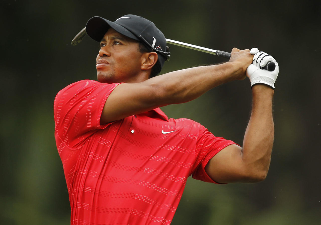 Tiger Woods hits from the 15th fairway during the final round of the Players Championship golf tournament at TPC Sawgrass, Sunday, May 13, 2012, in Ponte Vedra Beach, Fla. (AP Photo/Chris O'Meara)
