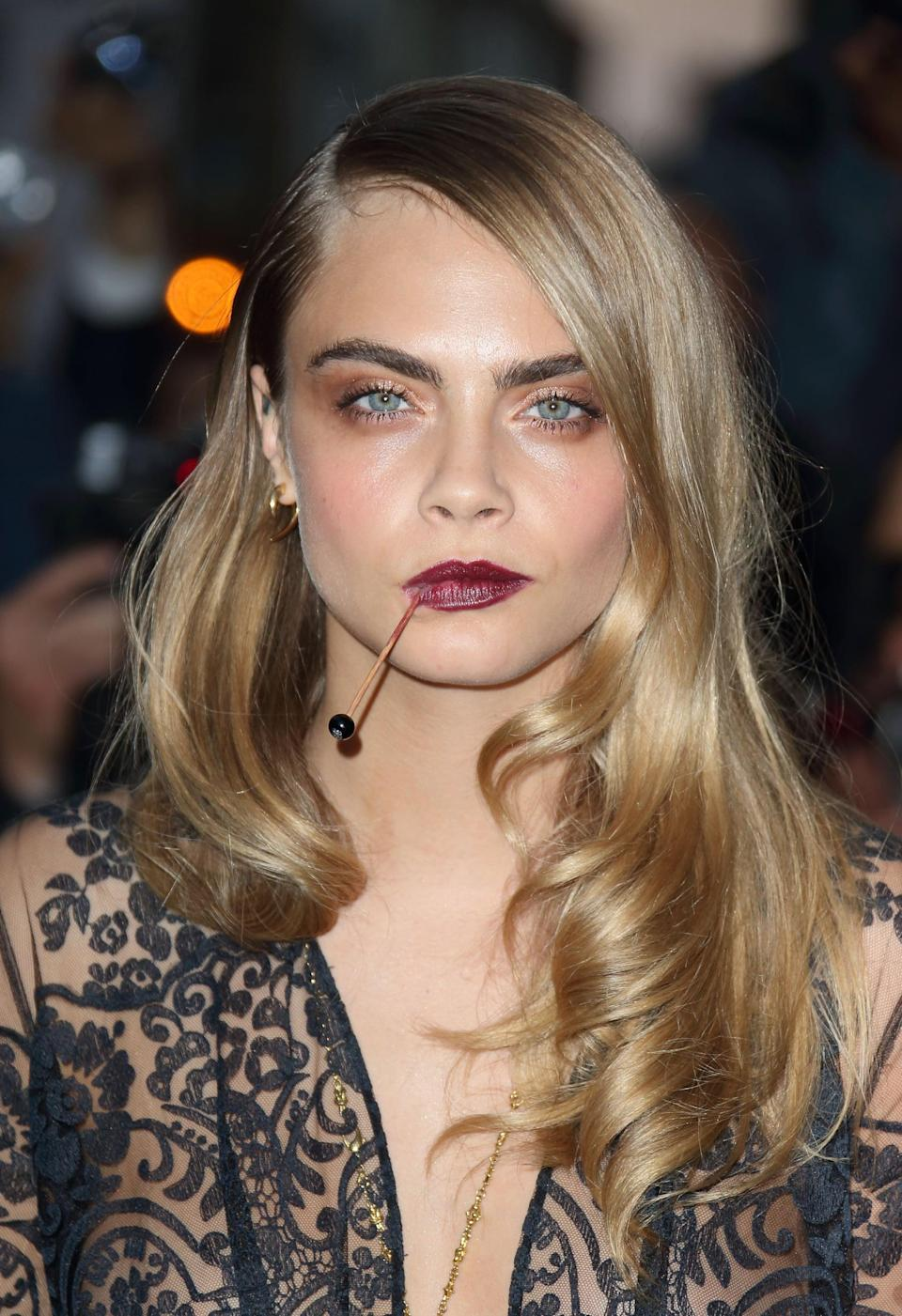 <p>Another red carpet, another side-parted, wavy style for Delevingne, who for the 2014 GQ Men of the Year Awards, tried the look with very little volume on top and lots of body at the bottom. </p>