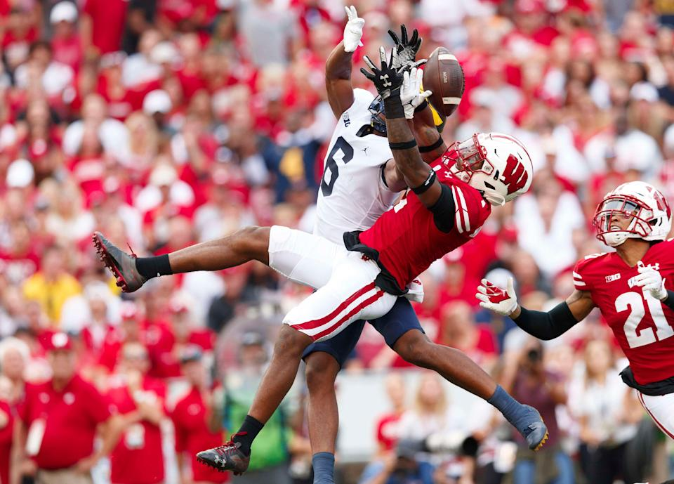 Wisconsin Badgers cornerback Faion Hicks (1) defends the pass intended for Michigan Wolverines wide receiver Cornelius Johnson (6) during the second quarter Oct. 2, 2021 at Camp Randall Stadium in Madison, Wisconsin.