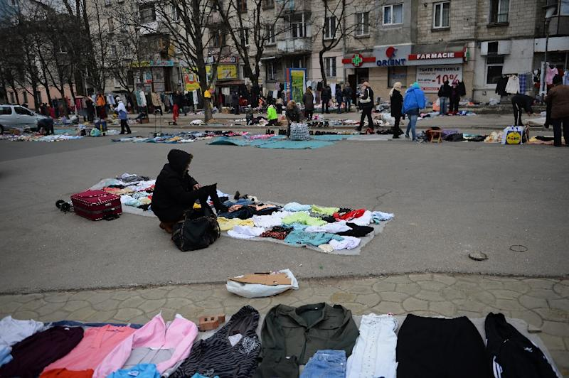 People sell second-hand goods in a square in Chisinau, Moldova, on March 27, 2015 (AFP Photo/Daniel Mihailescu)
