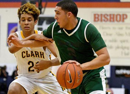 FILE PHOTO:    Dec 16, 2016; Las Vegas, NV, USA;  Chino Hills Huskies guard LiAngelo Ball (3) dribbles against the defense of Clark Chargers forward Jalen Hill (21) on the second day of the Tarkanian Classic at Bishop Gorman High School.  Stephen R. Sylvanie-USA TODAY Sports/File Photo