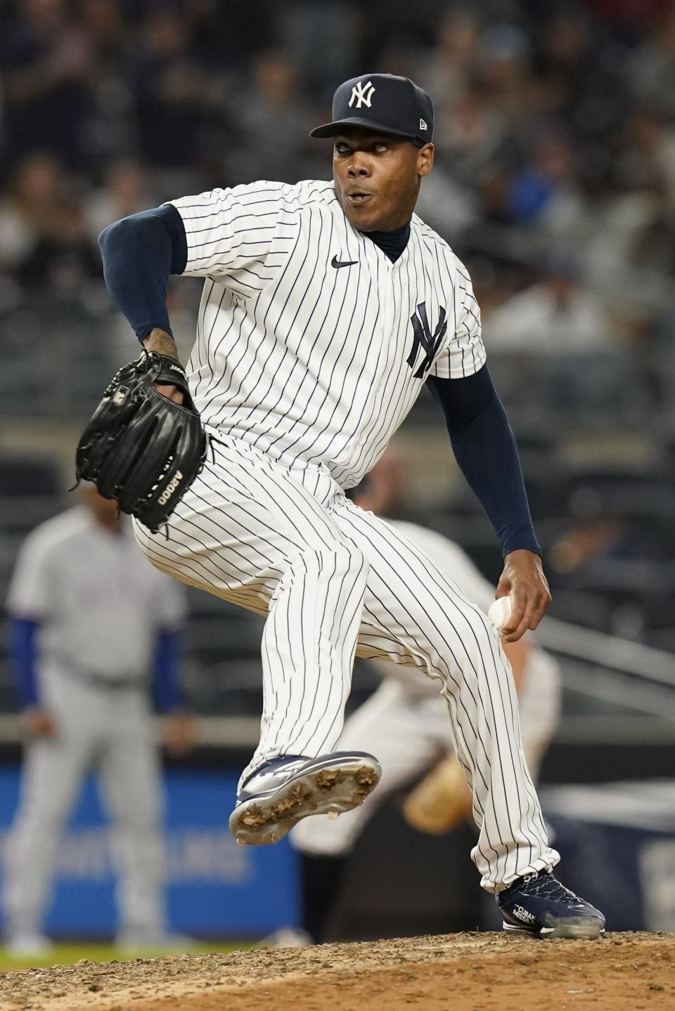 New York Yankees relief pitcher Aroldis Chapman delivers during the ninth inning of a baseball game against the Texas Rangers, Monday, Sept. 20, 2021, in New York. The Yankees won 4-3. (AP Photo/Frank Franklin II)