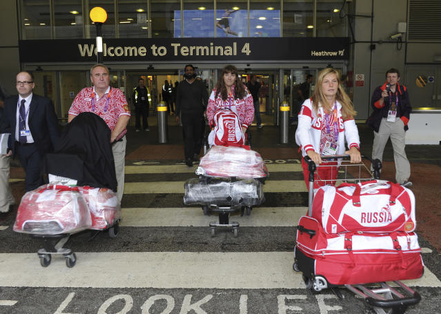 Tatiana Bazyuk (R) and Svetlana Shnitko (C) and of the Russian Olympic sailing squad arrive at Heathrow airport, London, July 16, 2012. The London 2012 Olympic Games start in 11 days time. REUTERS/Paul Hackett (BRITAIN - Tags: SPORT OLYMPICS)