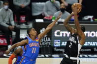 Oklahoma City Thunder guard Theo Maledon (11) defends against Los Angeles Clippers forward Kawhi Leonard (2) during the first quarter of an NBA basketball game Sunday, Jan. 24, 2021, in Los Angeles. (AP Photo/Ashley Landis)