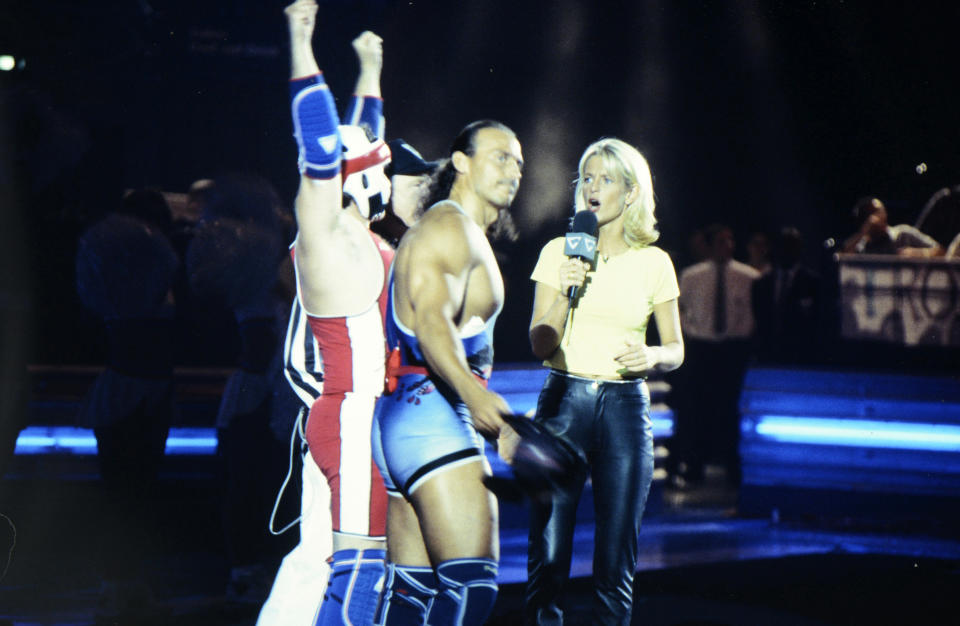 BIRMINGHAM, ENGLAND:  Wolf (Michael van Wijk) and host Ulrika Jonsson during the filming of Gladiators for Comic Relief at the National Indoor Arena in Birmingham, which was shown during the Red Nose Day telethon on March 14, 1997. The event raised over £27m for charitable causes. (Photo by George Bodnar/Comic Relief via Getty Images) (Photo by Comic Relief/Comic Relief via Getty Images)