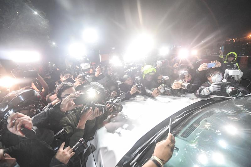 Journalists cover the arrival of Emilio Lozoya, former chief executive of Mexico's state oil company PEMEX, arriving at the General Attorney office following his extradition from Spain, in Mexico City on July 17, 2020. - Lozoya, PEMEX chief from 2012 to 2018, is accused of accepting millions of dollars in bribes from scandal-tainted Brazilian construction giant Odebrecht. (Photo by PEDRO PARDO / AFP) (Photo by PEDRO PARDO/AFP via Getty Images)