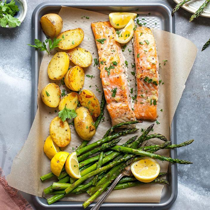<p>This spring-produce-packed one-pan meal makes a healthy and satisfying weeknight dinner. Melted garlic butter coats the salmon and vegetables, adding depth of flavor and richness to the dish.</p>