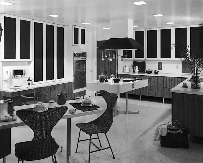"<p>By the mid-century, the kitchen had become a stylish gathering space. In 1953, <em>House Beautiful</em> wrote about this new era: ""The best measure of the revolution in the food world is that the kitchen has become a presentable living room. The kitchen has changed because the work done there is different, and because modern materials can look beautiful — yet still be practical."" This combo kitchen and dining area elegantly proves the point.</p>"