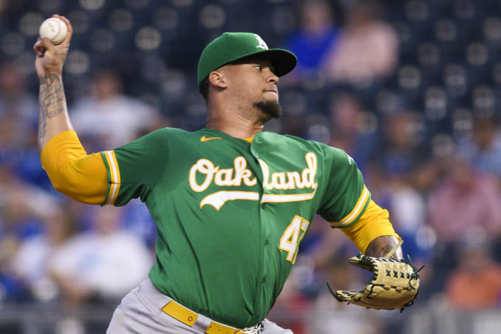Oakland Athletics starting pitcher Frankie Montas throws to a Kansas City Royals batter during the first inning of a baseball game, Tuesday, Sept. 14, 2021 in Kansas City, Mo. (AP Photo/Reed Hoffmann)