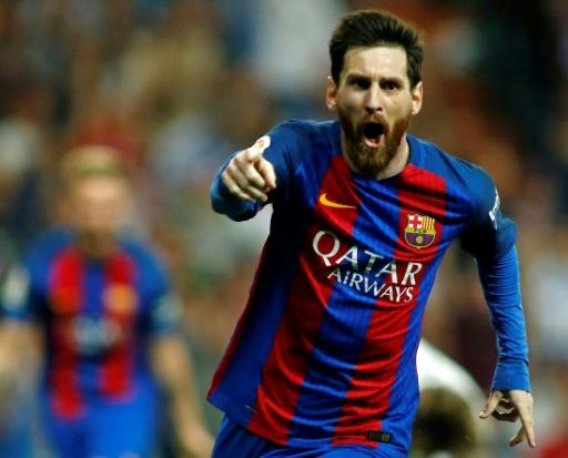 Barcelona's Argentinian forward Lionel Messi celebrates a goal during a Spanish league match against Real Madrid at the Santiago Bernabeu stadium in Madrid on April 23, 2017