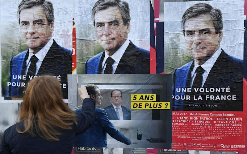 Poster of French presidential election candidate for the right-wing Les Republicains (LR) party Francois Fillon - AFP