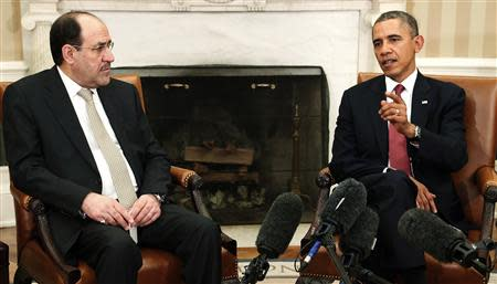U.S. President Obama and Iraq's PM Maliki talk to reporters in the Oval Office after meeting at the White House in Washington