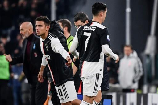 Cristiano Ronaldo (R) was furious after being substituted for Juventus teammate Paulo Dybala (L) against AC Milan on November 10