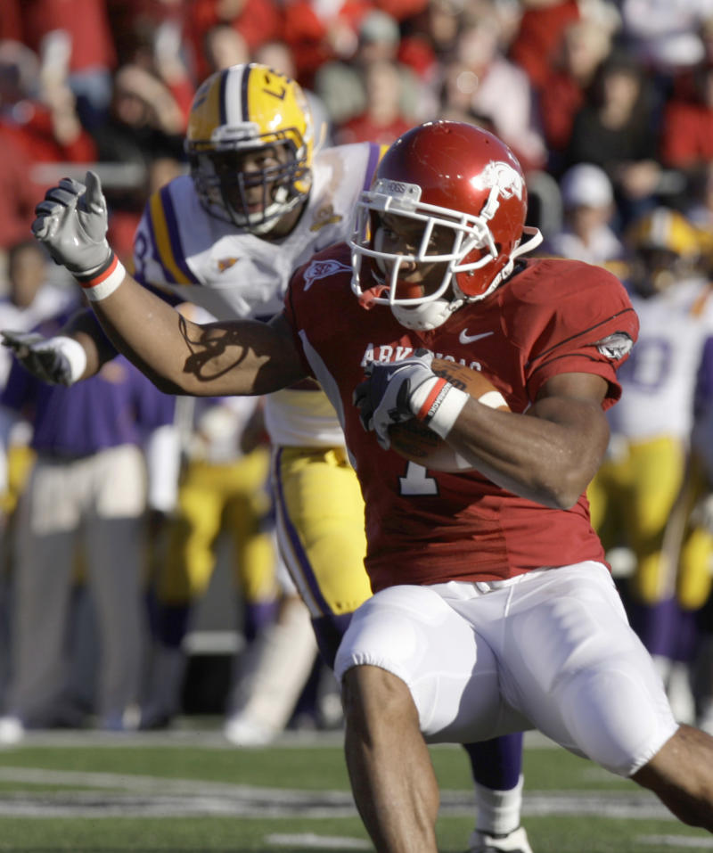 Arkansas running back Knile Davis (7) runs for a touchdown as he is pursued by LSU defensive end Barkevious Mingo during the first quarter of an NCAA college football game in Little Rock, Ark., Saturday, Nov. 27, 2010. (AP Photo/Danny Johnston)