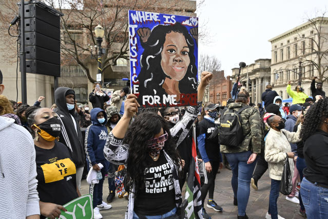 FILE - In this March 13 2021 file photo a protester holds up a painting of Breonna Taylor during a rally on the one year anniversary of her death at Jefferson Square Park in Louisville Ky On Friday April 9 2021 Gov Andy Beshear has signed a partial ban on no-knock warrants a year after the fatal shooting of Taylor AP PhotoTimothy D Easley