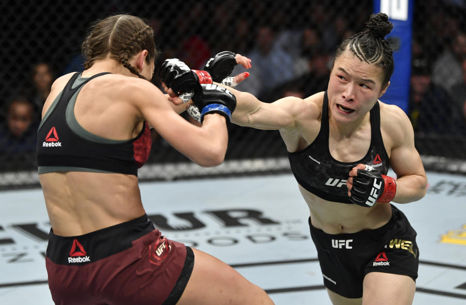 LAS VEGAS, NEVADA - MARCH 07: (R-L) Zhang Weili of China punches Joanna Jedrzejczyk of Poland in their UFC strawweight championship fight during the UFC 248 event at T-Mobile Arena on March 07, 2020 in Las Vegas, Nevada. (Photo by Jeff Bottari/Zuffa LLC)