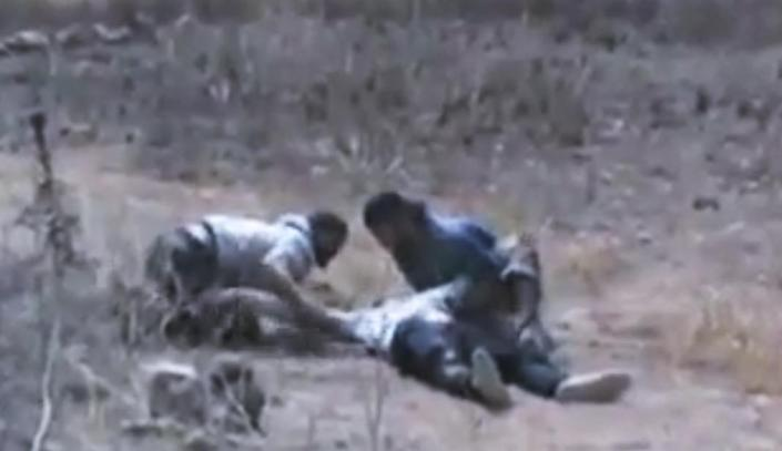 This image made from amateur video released by Ugarit News and accessed Thursday, June 21, 2012, purports to show Syrians helping a wounded man at Baba Amr neighborhood in Homs Province, Syria. A spokeswoman for the International Committee of the Red Cross says aid workers teams will try to evacuate wounded and sick civilians and those who want to leave rebel-held areas in the embattled central Syrian city of Homs. (AP Photo/Ugarit News via AP video) TV OUT, THE ASSOCIATED PRESS CANNOT INDEPENDENTLY VERIFY THE CONTENT, DATE, LOCATION OR AUTHENTICITY OF THIS MATERIAL