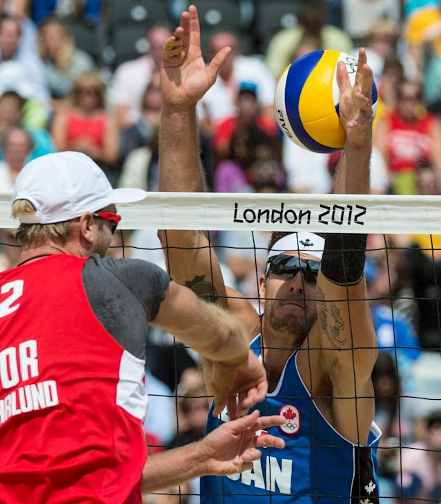 Canada's Martin Reader misses a block during preliminary beach volleyball action against Tarjei Viken Skarlund and Martin Spinnangr at the 2012 London Olympics, on July 30, 2012. Reader and his partner Joshua Binstock lost two sets to none. COC Photo: Jason Ransom