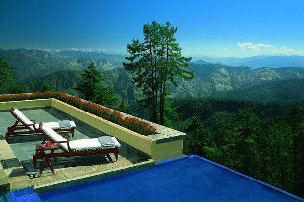 Pool side at the Wildflower Hall, Shimla in the Himalayas - Drive up to the snow-capped retreats of Shimla and go trekking or skiing together. Kufri and Narkanda are popular spots.  Top it up with a stay at Wildflower Hall, Shimla in the Himalayas by Oberoi Hotels for a memorable experience. Nestled high in the hills amidst 22 acres of pine and cedar forest, the hotel has two restaurants, a bar and butler service.