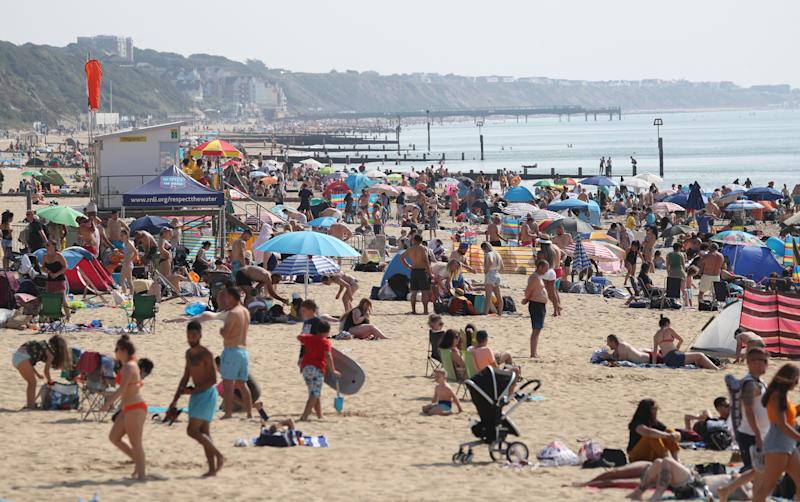 People enjoy the hot weather at Bournemouth beach in Dorset. (Photo by Andrew Matthews/PA Images via Getty Images)