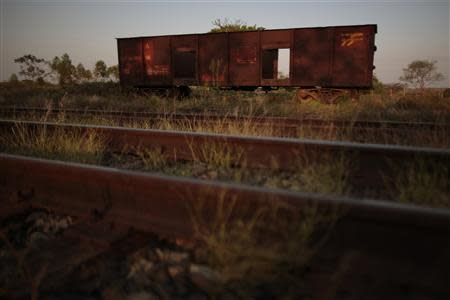 Abandoned train wagons are pictured on the tracks of the Goias Railroad, a little used train line built more than 100 years ago to link cities in southwestern Brazil, in Calambau, Goias State, September 26, 2013. REUTERS/Ueslei Marcelino