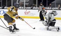 Vegas Golden Knights left wing William Carrier (28) shoots as Los Angeles Kings goalie Calvin Petersen (40) defends during the second period of an NHL hockey game Sunday, Feb. 7, 2021, in Las Vegas. (AP Photo/Isaac Brekken)