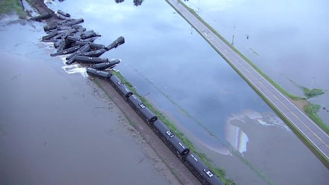 Tanker cars from a freight train carrying crude oil are shown after a derailment along the Rock River south of Doon, Iowa, U.S. in this June 22, 2018 handout still image taken from aerial drone video. Sioux County Sheriff's Office/Handout via REUTERS ATTENTION EDITORS - THIS IMAGE WAS PROVIDED BY A THIRD PARTY. TPX IMAGES OF THE DAY