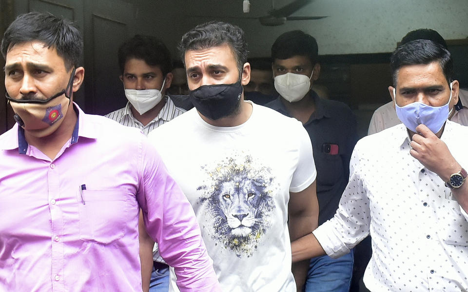 MUMBAI, INDIA - JULY 23: Raj Kundra being taken to Killa Court from Property Cell Unit office at Byculla in Porn Racket case on July 23, 2021 in Mumbai, India. Actress Shilpa Shettys husband Kundra and his business associate Ryan Thorpe were produced before the Magistrate Court at the end of their earlier three-day police remand on Friday. Police sought an extension of their custody to probe the matter further. The police had earlier told the court that the 45-year-old businessman was gaining financially from the illegal activity of making and selling pornographic material. (Photo by Anshuman Poyrekar/Hindustan Times via Getty Images)