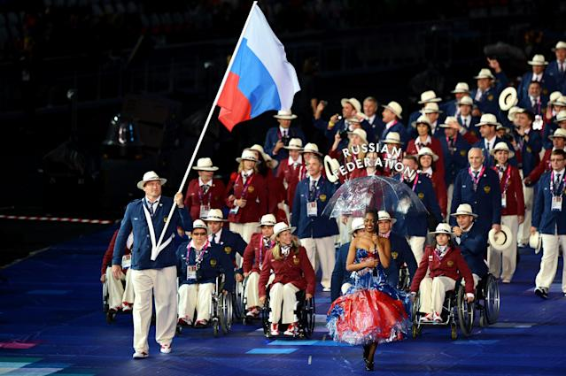 LONDON, ENGLAND - AUGUST 29: Alexey Ashapatov of Russia carries the flag during the Opening Ceremony of the London 2012 Paralympics at the Olympic Stadium on August 29, 2012 in London, England. (Photo by Gareth Copley/Getty Images)