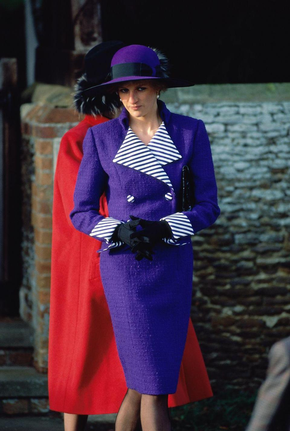 <p>In a purple coat with striped detailing and matching hat at Christmas Day Services at St. Mary Magdalene Church in Sandringham.</p>