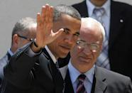 In this photo taken on July 23, 2008, then US Senator and Democratic presidential candidate Barak Obama waves to the press as he is welcomed by Senior Palestinian negotiator Saeb Erakat in the West Bank city of Ramallah
