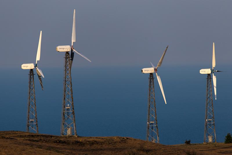 REPUBLIC OF CRIMEA, RUSSIA - JUNE 11, 2020: Wind turbines on Cape Meganom. Sergei Malgavko/TASS (Photo by Sergei Malgavko\TASS via Getty Images)