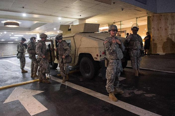 North Carolina's governor has declared a state of emergency in Charlotte, and several hundred National Guard troops were deployed to reinforce local police (AFP Photo/Nicholas Kamm)