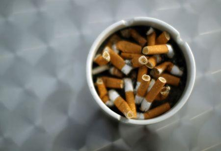 FILE PHOTO: An ash tray with cigarette butts is pictured in Hinzenbach, in the Austrian province of Upper Austria, February 5, 2012.  REUTERS/Lisi Niesner