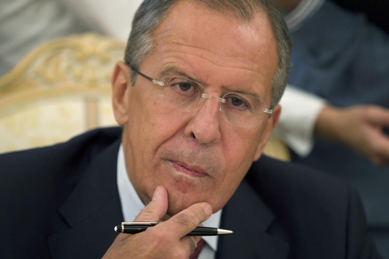 Russian Foreign Minister Sergey Lavrov listens to Libyan Foreign Minister Mohamed Abdelaziz, in Moscow on Tuesday, Sept. 10, 2013. Lavrov and Abdelaziz focused on cooperation in the energy and investment sectors at negotiations in Moscow. (AP Photo/Ivan Sekretarev)