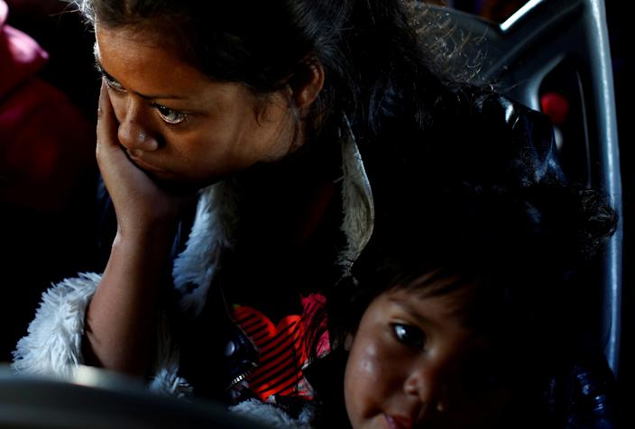 <p>A migrant woman and a girl, part of a caravan of thousands traveling from Central America en route to the United States, sit in a bus while the bus stop for them to get food and water from a store on a highway in Culiacan, Mexico, Nov. 15, 2018. (Photo: Kim Kyung-Hoon/Reuters) </p>